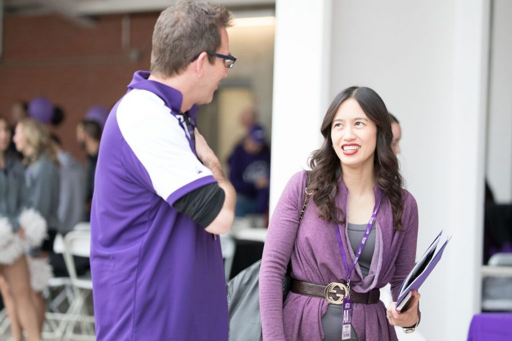 Two people talking at an event
