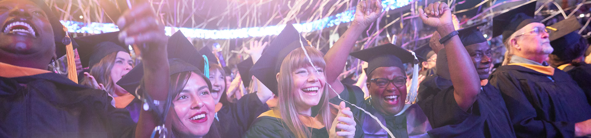 GCU students celebrating at commencement ceremony