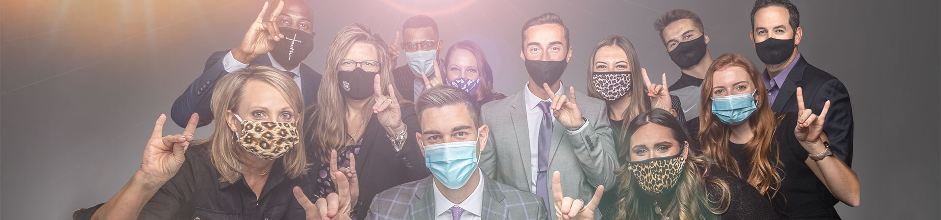 GCU Advancement team wearing masks and giving Lopes Up sign